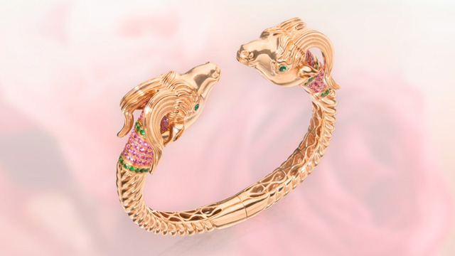 18 Karat Rose Gold, Pink Sapphire, Tsavorite Garnet and Emerald Bangle-Bracelet, Alexander Laut. Credit: Sothebys.