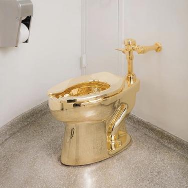 """America"" – The Guggenheim's gold toilet installation by Maurizio Cattelan. Photo: Kris McKay, via @Guggenheim on Instagram."