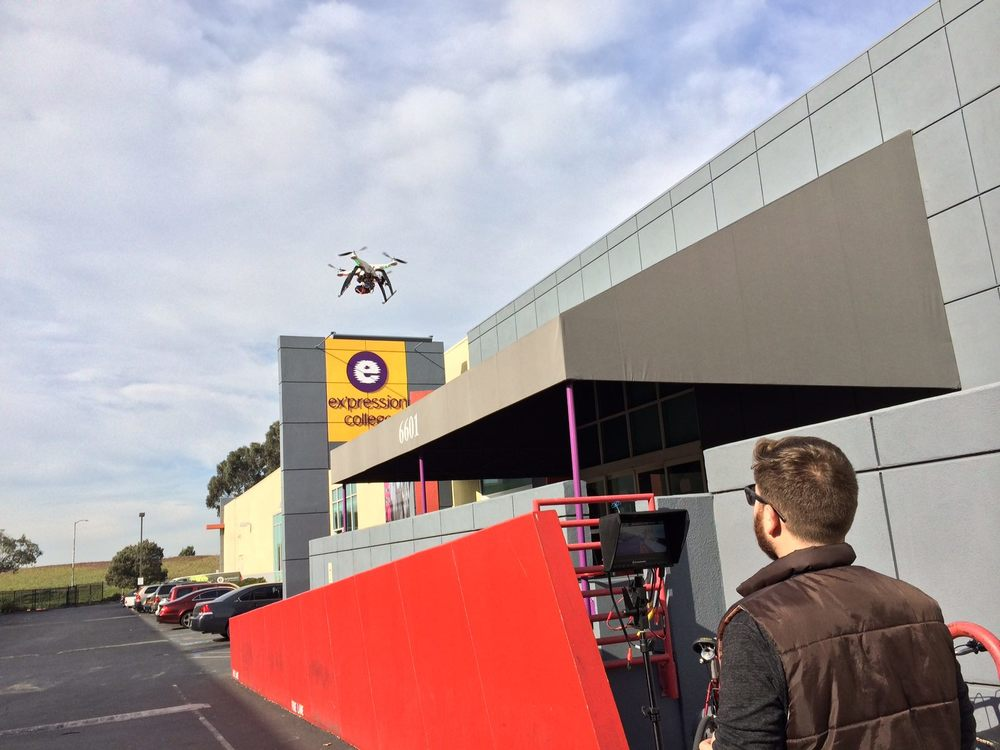 Piloting a quad copter with a GoPro Here 3 outside of Ex'pression College. Whatever it takes to get the shot.