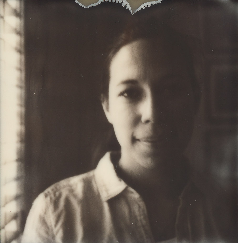 My serious artist portrait on a real Polaroid by  D  a Ping Luo