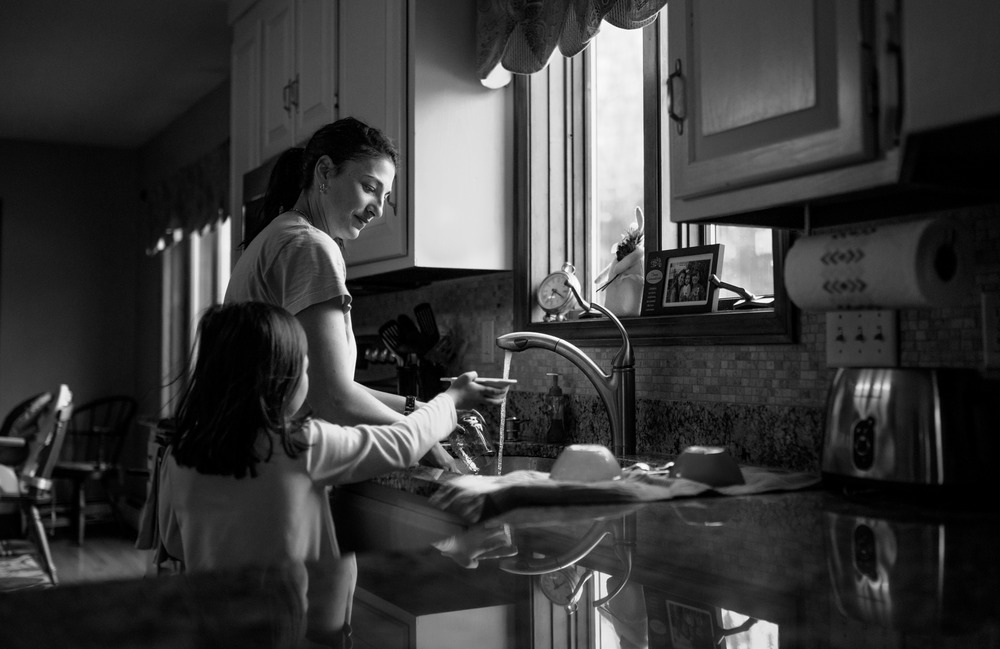 Mom and Daughter Doing Dishes