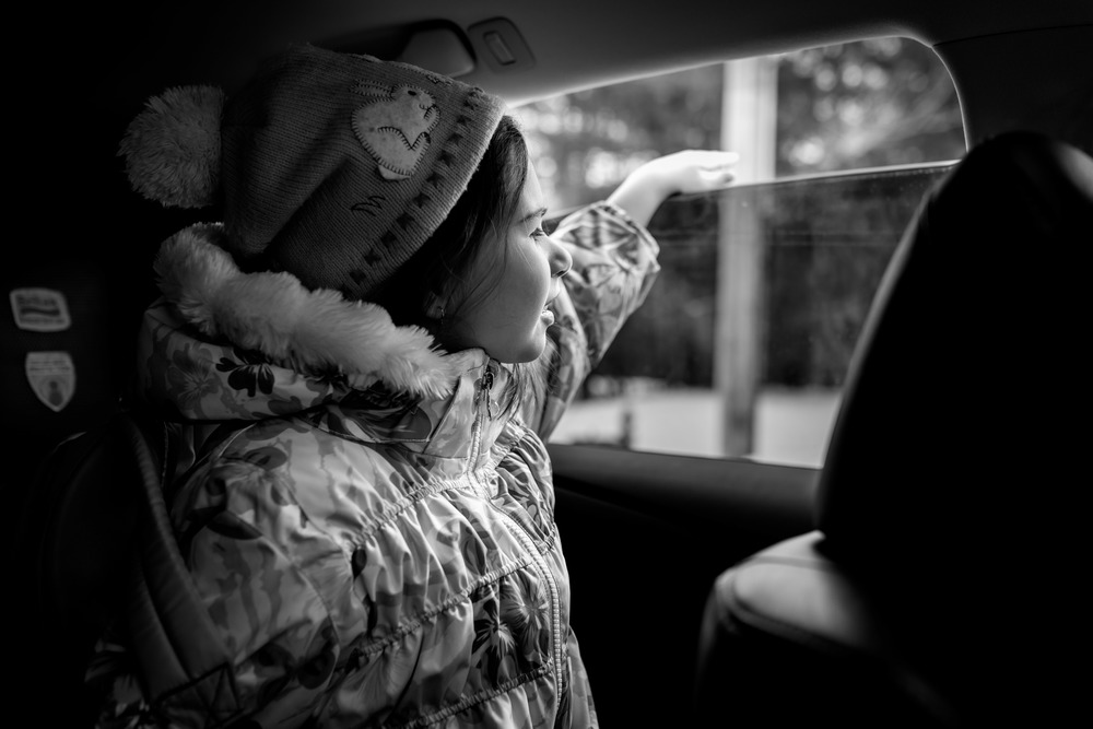 Daughter Looking Out of Car Window