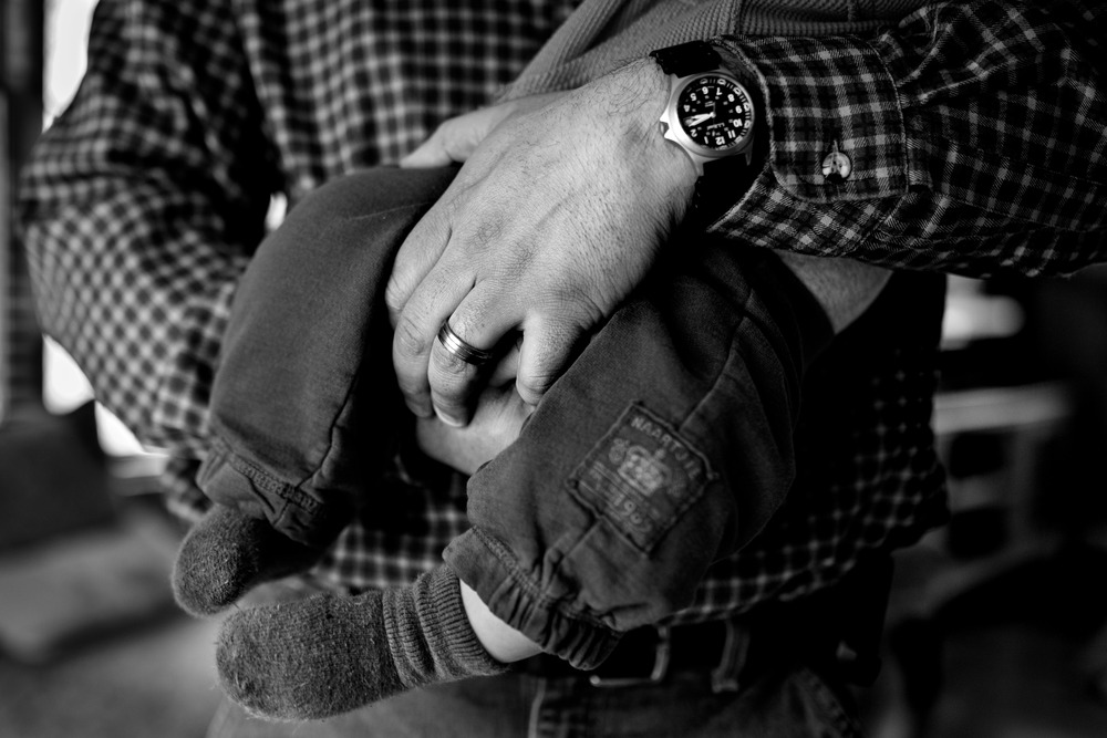 Dad's Hands While Holding Son