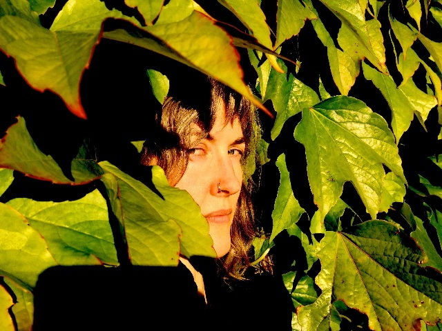 Allison Beda  in leaves small photo by David Hauka.jpg