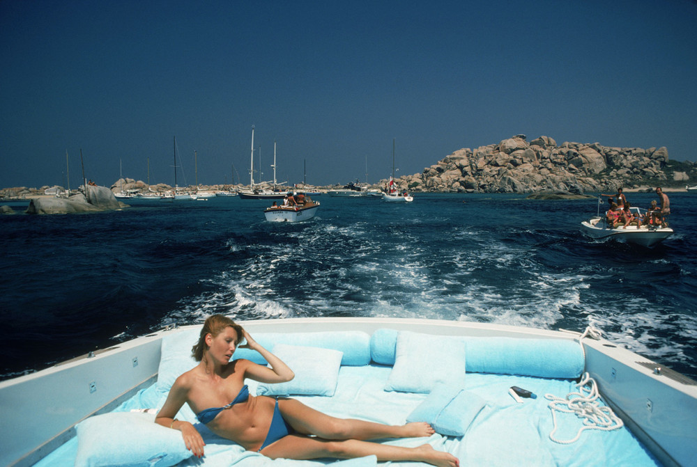Slim Aarons, Princess Pia Ruspoli, sailing off Mortorio Island, Italy, 1978. C-print.