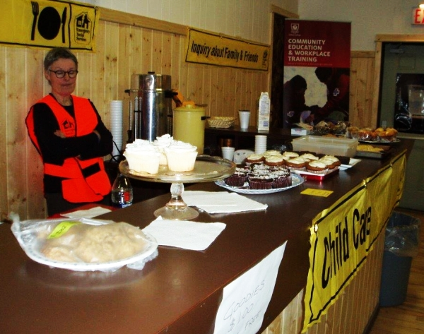 ESS volunteer at the bake sale table, as a fundraiser for another local communtiy group - March 12 2016 OHELP event. (Open House for Emergency Learning and Preparedness).