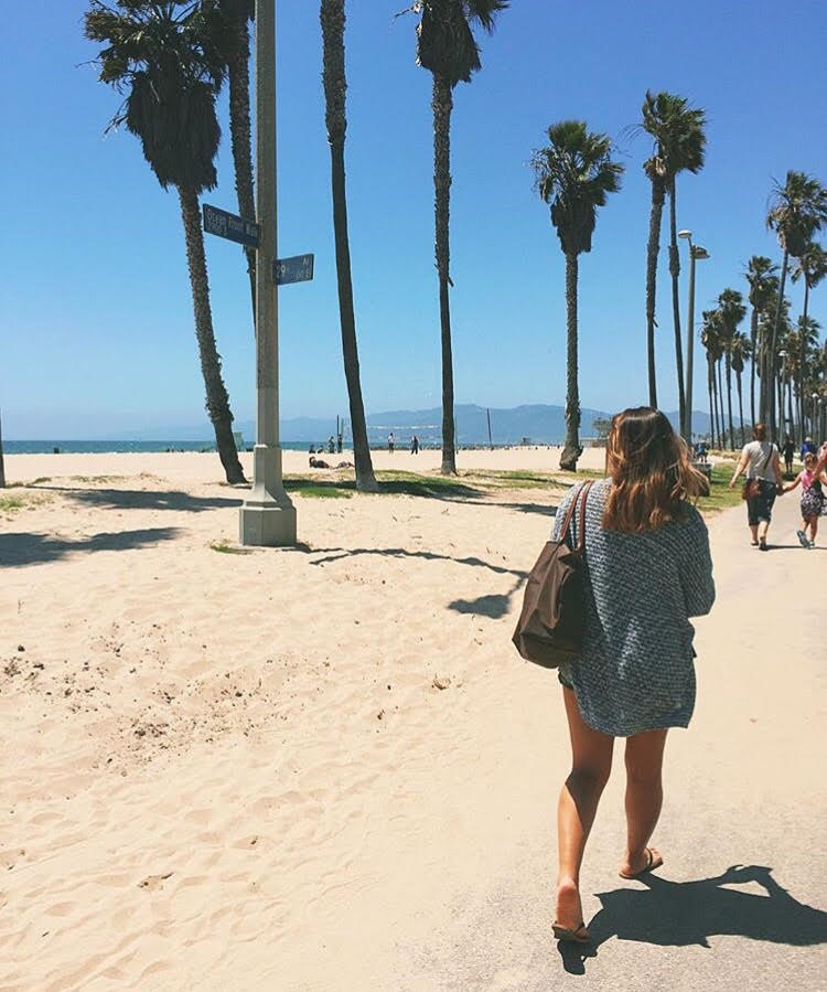 My younger sister, Simone, walking adjacent to Venice beach during her visit with us.