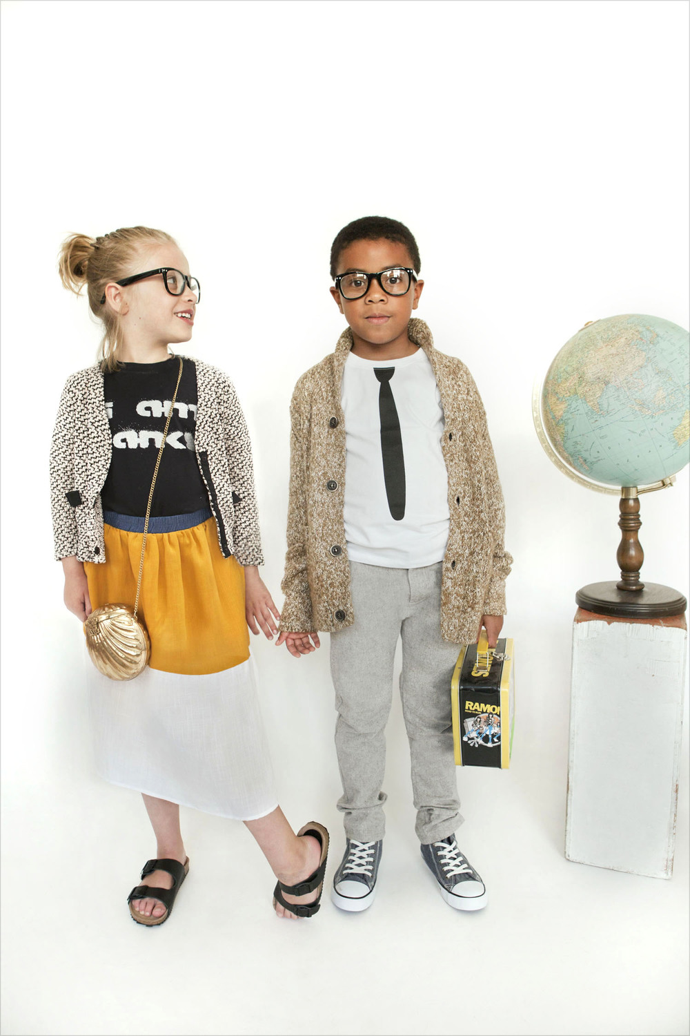 "ON HER: Teeny Tiny Optics glasses, Hatch for Kids ""I am Banksy"" tee shirt, Millions of Colors jacket, La Miniatura skirt, Zara sandals, vintage bag.  ON HIM: Teeny Tiny Optics glasses, Zara sweater, Oh Baby London long sleeve tee shirt, Zara trousers, H & M sneakers, Ramones lunchbox."