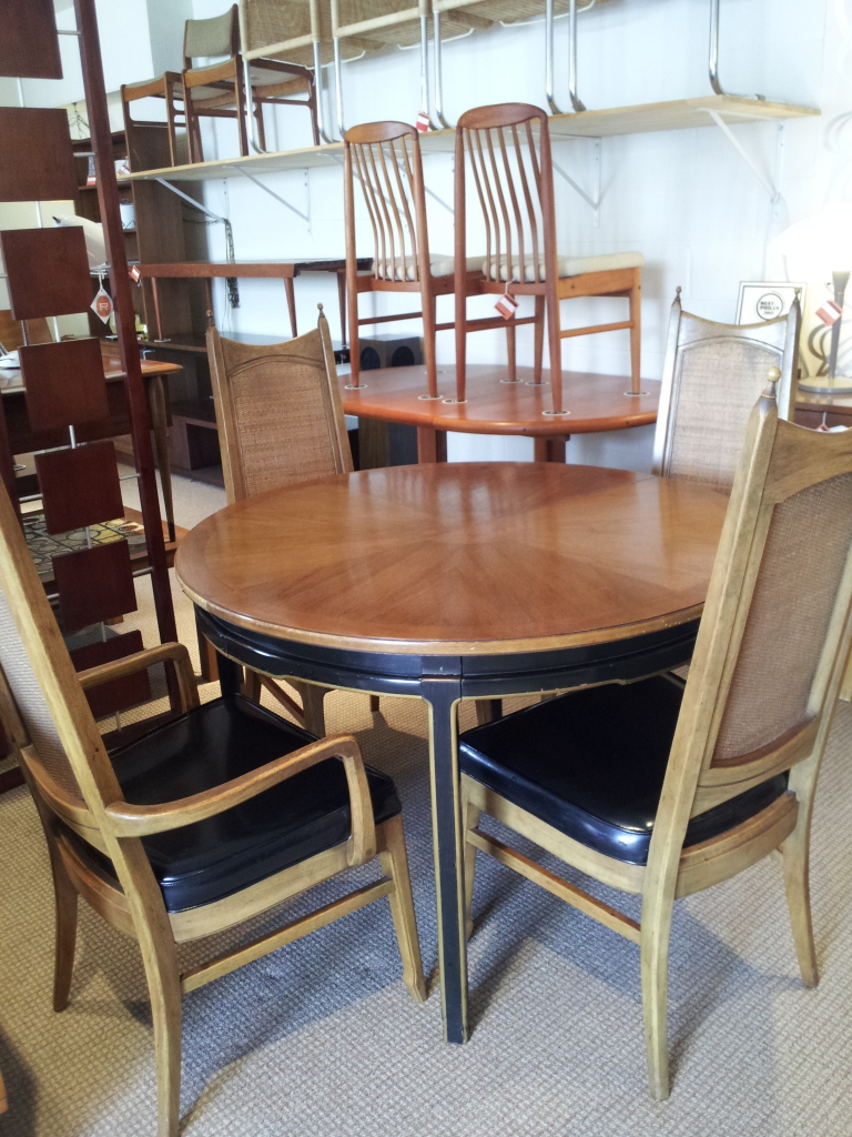 Art deco, caned back, and finials for a more elegant look.  This table comes with two leaves and includes the chairs in the price.  This one is also ON SALE!