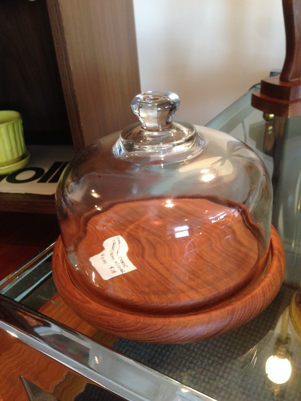 Teak cheese tray with glass lid. Teak, walnut, and rosewood were all popular during the era because of their warm colors.