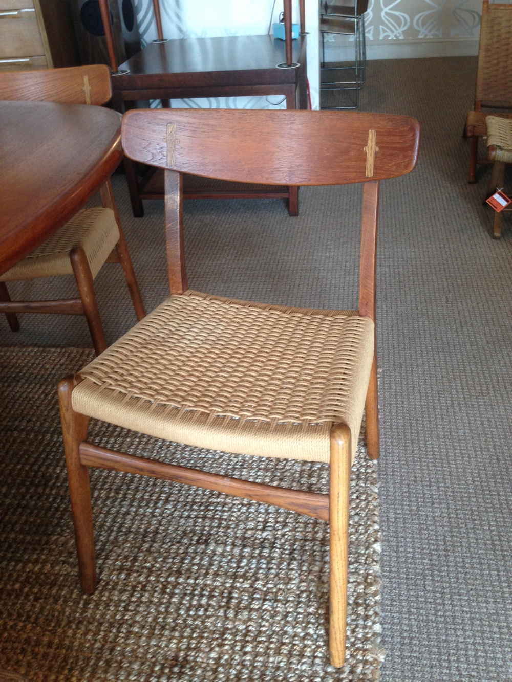 These Hans Wegner c23 dining chairs also have beautiful teak frames with oak inlay design.