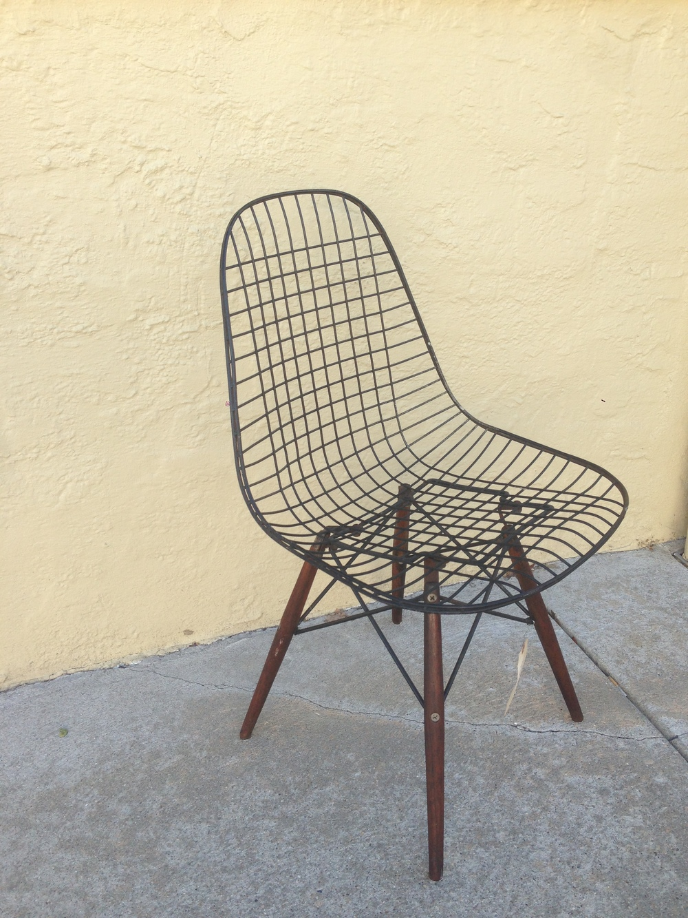 Eames DKW-1 chair manufactured by  Herman Miller, 1952-1954. Due to their delicate wooden leg joints, it is rare to find these chairs in tact. We currently have two of these in stock!
