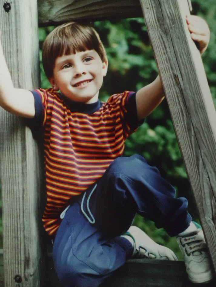 Lookin like a total boss/young male model on the giant wooden swing set next to our house. Please note my classy velcro barney sneakers.