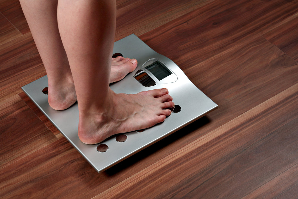woman-feet-on-weight-scale-17556187.jpg