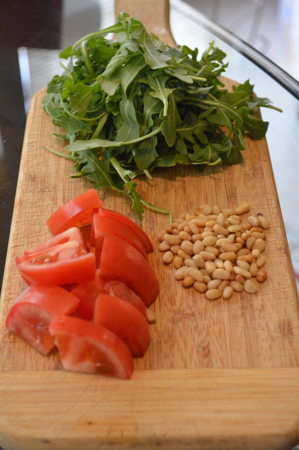 Arugala, Pine Nuts, Tomato