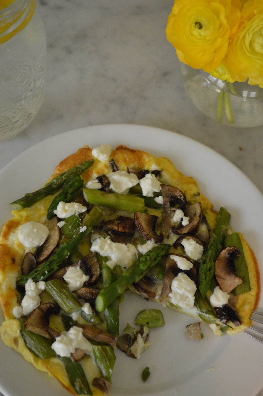 open faced veggie & goat cheese omelette