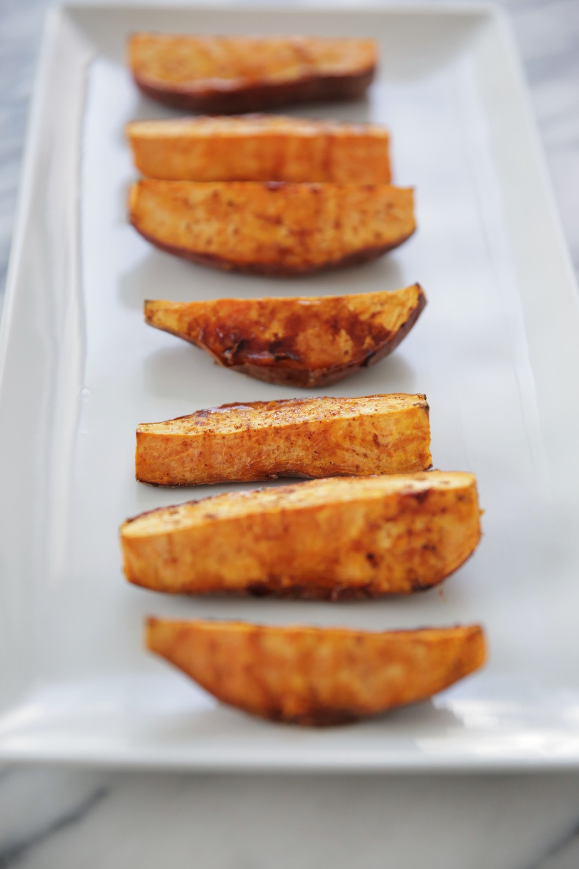 LaurenSchwaiger-Healthy-Life-Style-Blog-Roasted-Sweet-Potatoes-Cayenne-Cinnamon-Maple-Syrup.jpg