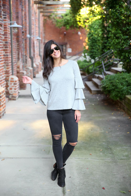grey-bell-sleeve-sweatshirt-black-skinny-jeans-lauren-schwaiger-street-style.jpg