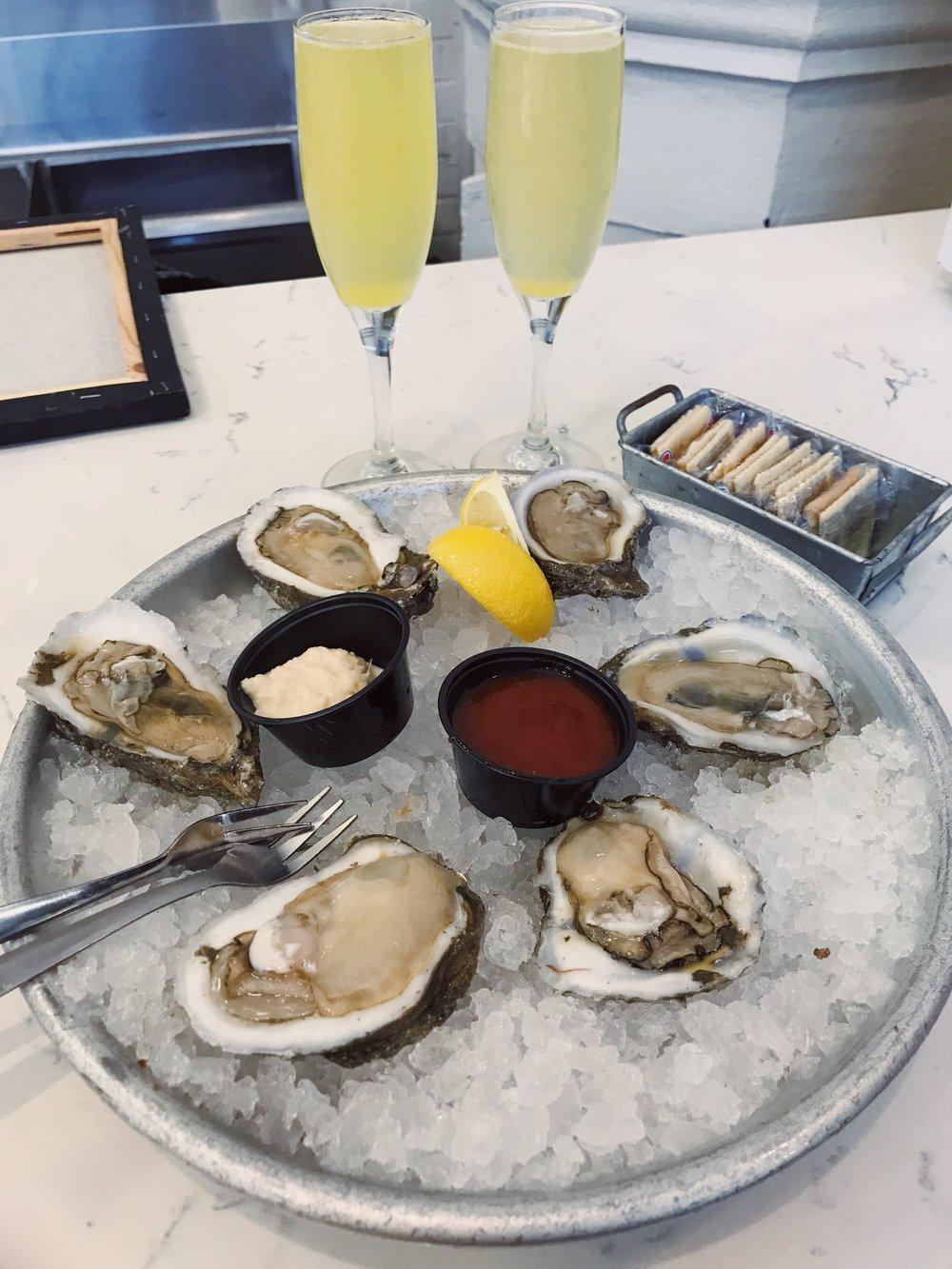 oysters-mimosas-st-roche-market-nola-lauren-schwaiger-travel-blog.jpg