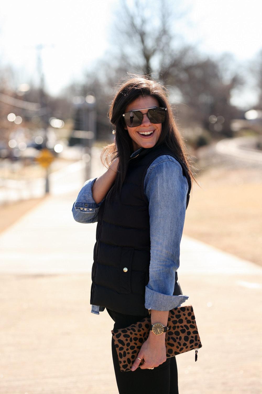jean-shirt-black-puffer-vest-leopard-print-clutch-outfit-inspiration.jpg