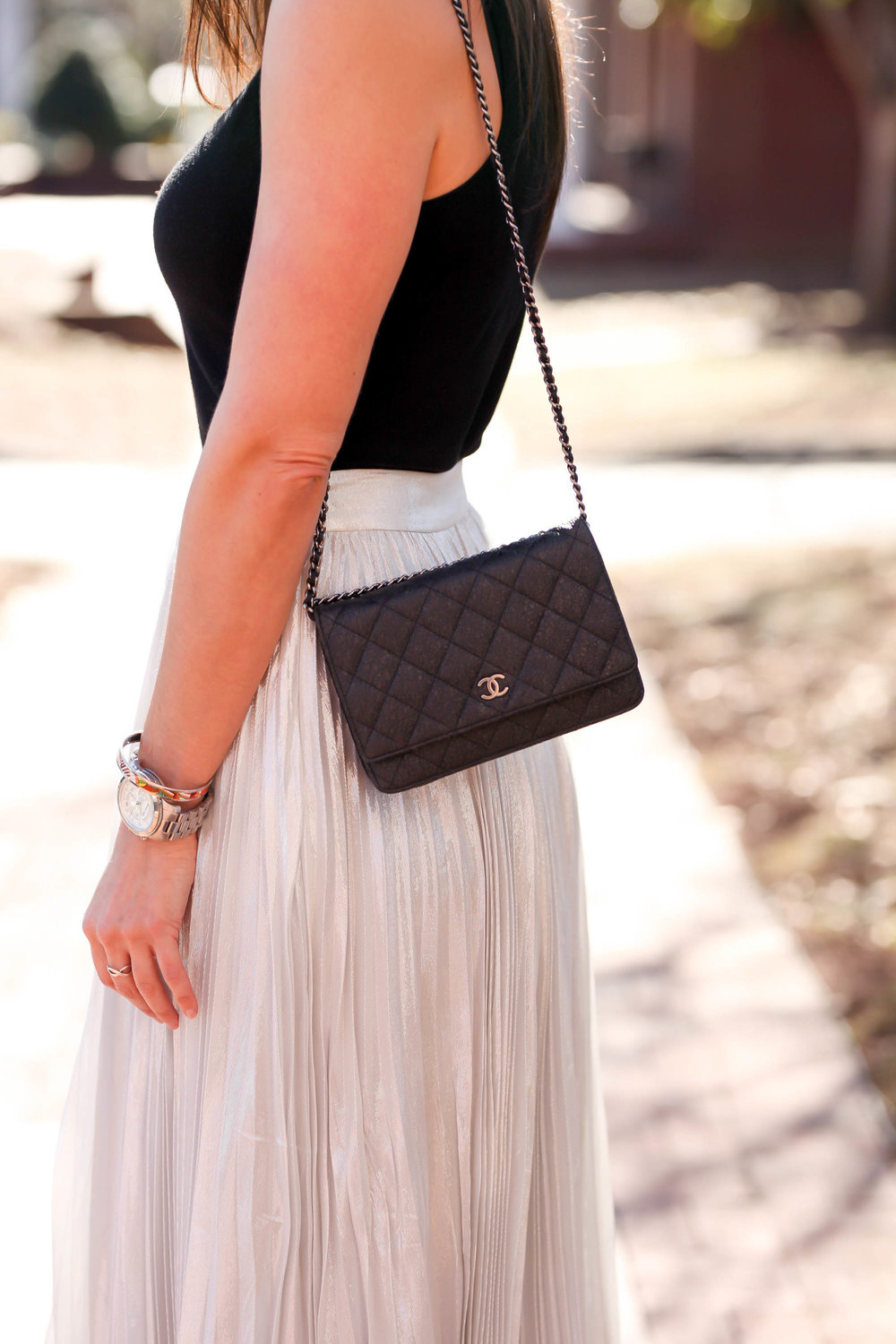 pleated-silver-skirt-classic-quilted-chanel-clutch-lauren-schwaiger-blog.jpg