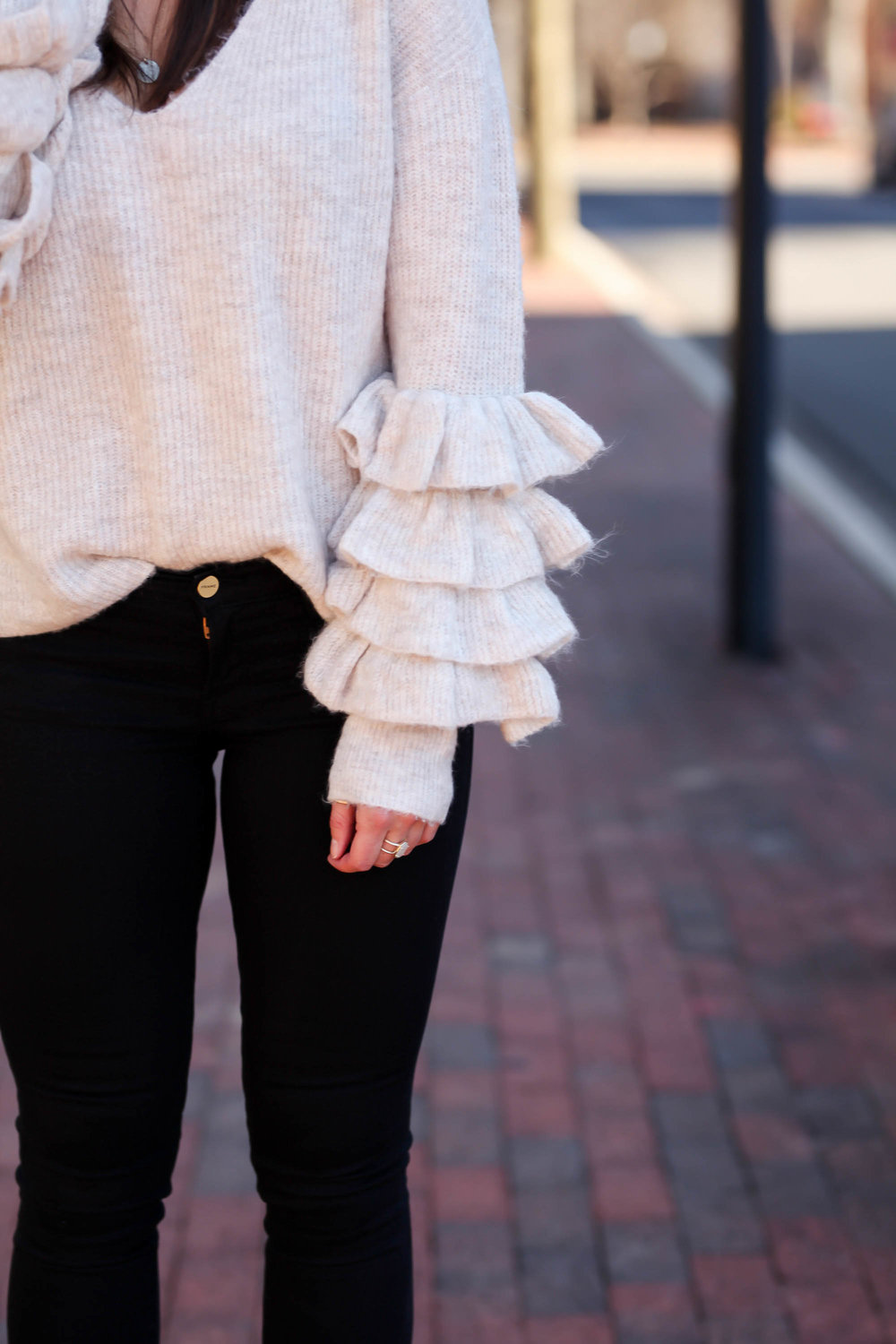 ruffle-sleeve-sweater-black-denim-chic-workwear-inspiration.jpg