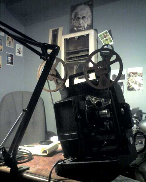 Finally bought a working 8mm projector. It also came with a 7 min. long role of footage of women posing in dresses around Tucson in the 1950s.