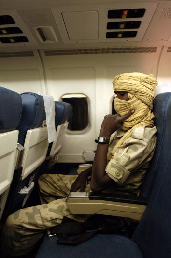 Member of Sudanese Militant Group on Plane to Peace Talks   Adam Yahia Ismain, member of the collective leadership of Sudanese rebel group Justice and Equality Movement, sleeps on the flight taking him from Juba, Sudan, to Sirte, Libya, where Darfur peace talks will take place.  24/10/2007. Sudan/Libya. UN Photo/Fred Noy.  unmultimedia.org/p