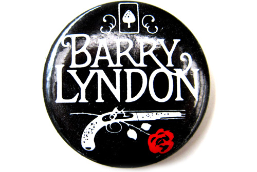 holdbacktomorrow :       No Futura   Stanley Kubrick was a fan of modernist, sans-serif fonts, but the notoriously fussy director chose a hand drawn, swash-serif logotype for  Barry Lyndon . Here it appears on a promotional button, deftly channeling both 1750 and 1975.       So excited that this is finally coming out on  blu-ray .