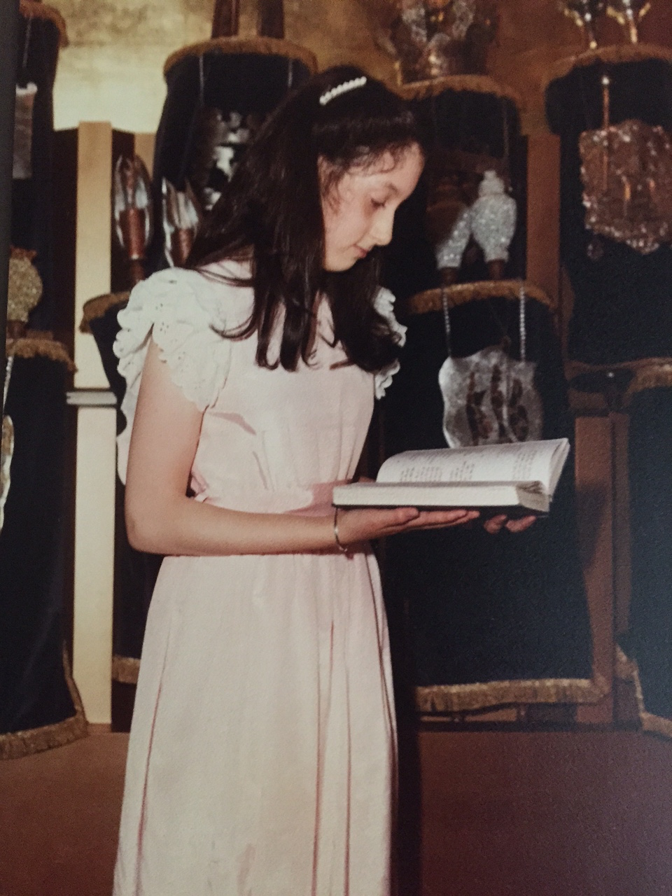 Erika Dreifus, pictured in front of the Torah scrolls at her home congregation in New Jersey, 1982.
