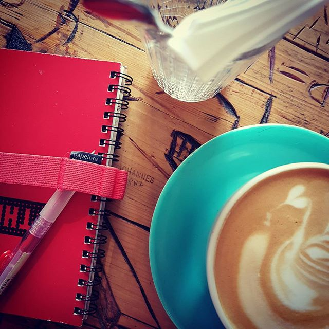 Work and coffee in Prague.  #prague #instaprague #visitprague #workingholiday #digitalnomad #notebook #coffeeyouneed #planning #writerslife #writersofinstagram #iloveprague #lattelove #red #ilovecoffee