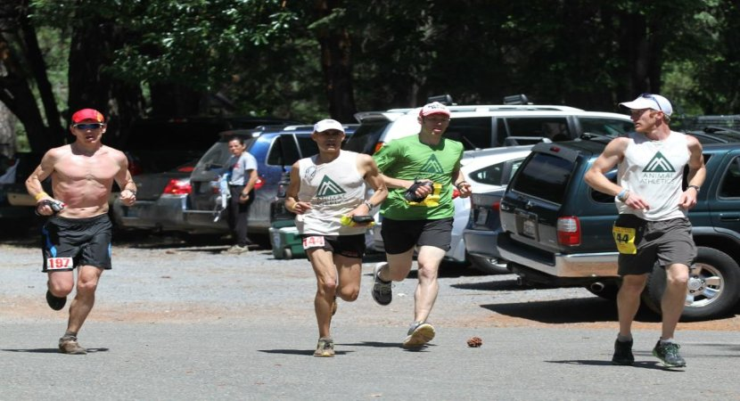 2012 Western States 100-miler (California) Coming into the Foresthill Aid Station at approximately mile 62 with Neal Gorman (left) and pacers/crew Joe Kleffner and Willie McBride. Photo: Bob MacGillivray