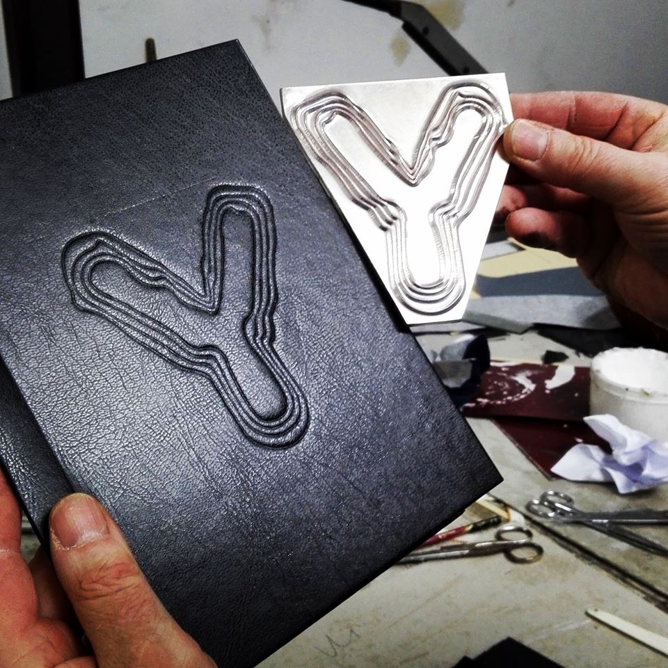 Leather covers of the notebooks being embossed!