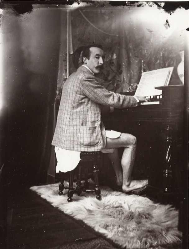 weirdvintage :     Artist Paul Gaugin playing the harmonium in his underwear in Alfonse Mucha's studio in Paris, c. 1895 (via  Retronaut )      Optimal harmonium-playing attire.