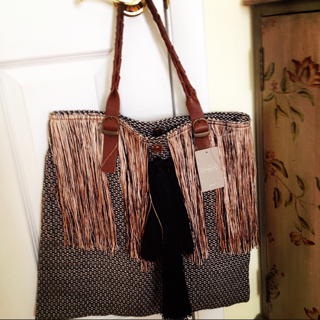 The safest way to wear fringe is on a handbag.