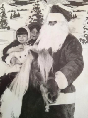 Me & Douglas. Circa A Christmas During the 1970's. Does Santa look creepy or what?