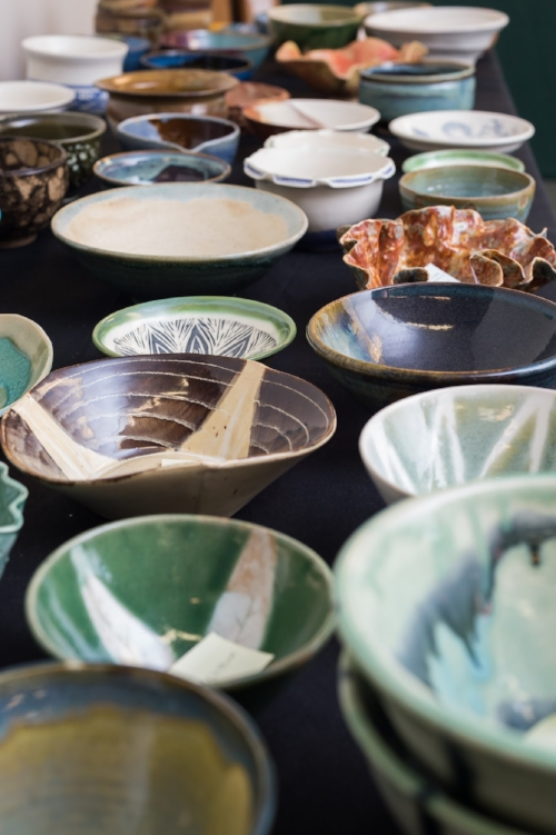 Some of the bowls that have been handcrafted by area artists for this month's event, photo by Stacey Doyle