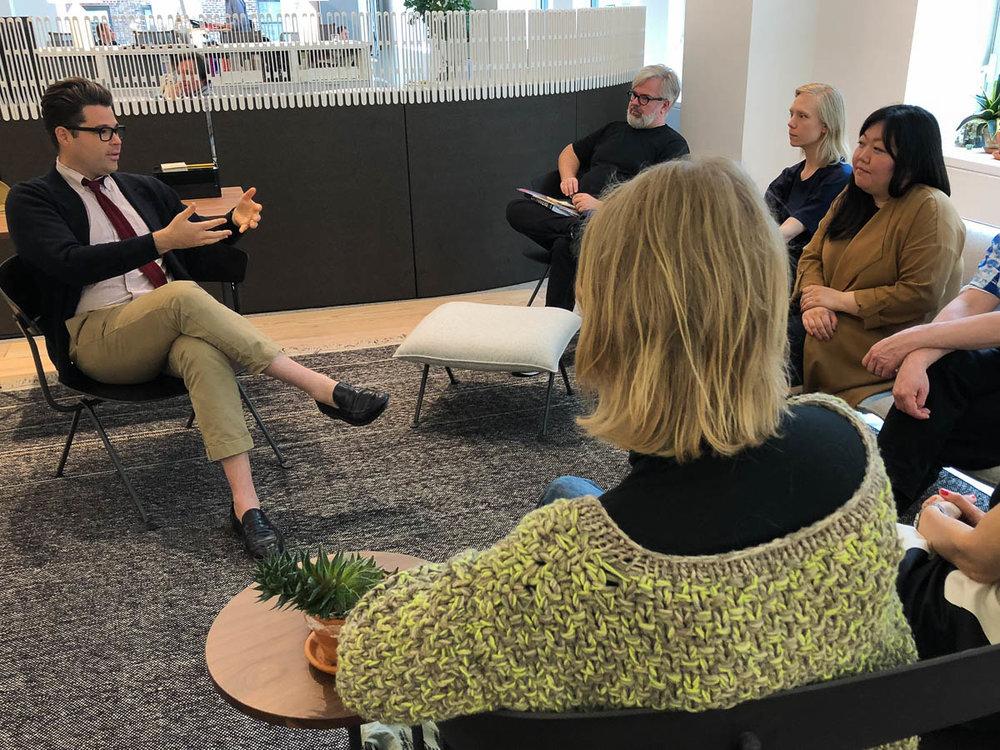 Aaron Miller, Brand Content Editor of Herman Miller, welcomed the mentoring group to Herman Miller's showroom.