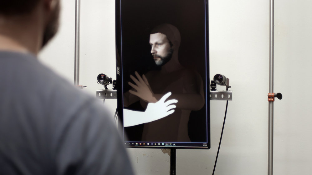 Captu r ed  is a participatory installation, which captures your face and creates a new identity for you in a collective scenario taking place in virtual world. Image: Hanna Haaslahti.
