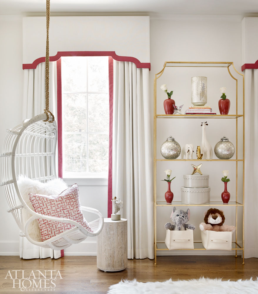 Elegant soft red and white decor in room with white rattan swing - Atlanta show house 2016
