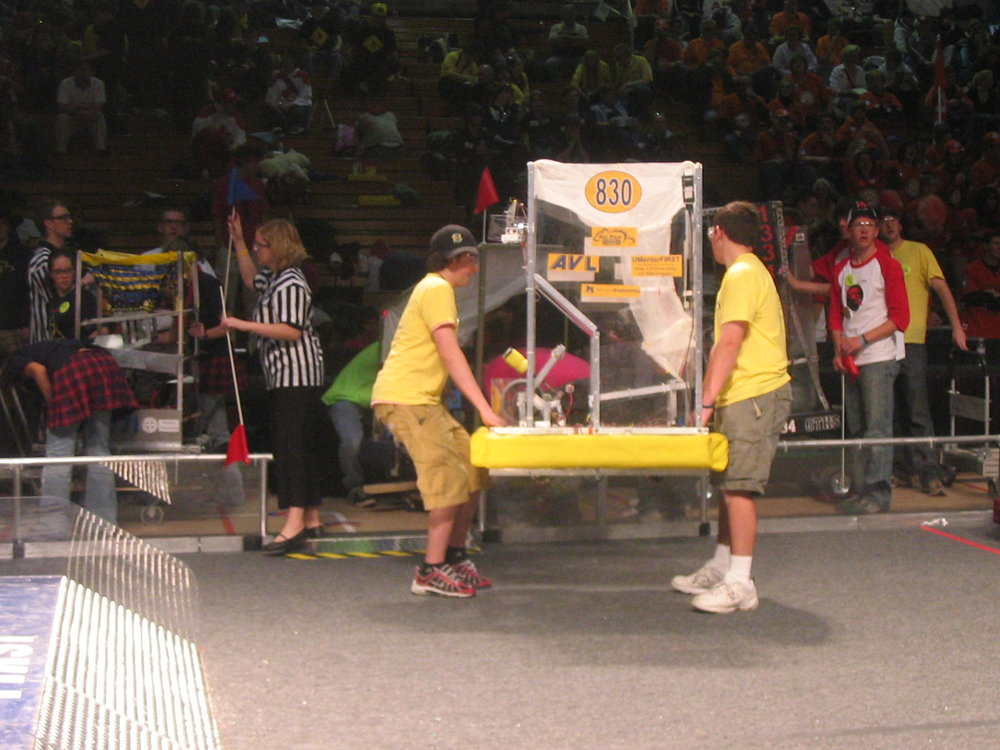 The 2006 drive team carrying the robot off the field.