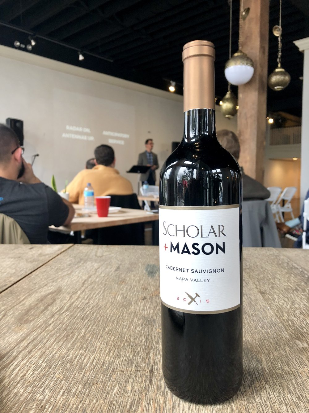Dr. Will Gray sharing about insights from the Ritz Carlton's leadership summit, at Flourishment February. Every month there is a drawing for a bottle of wine from Napa Valley.