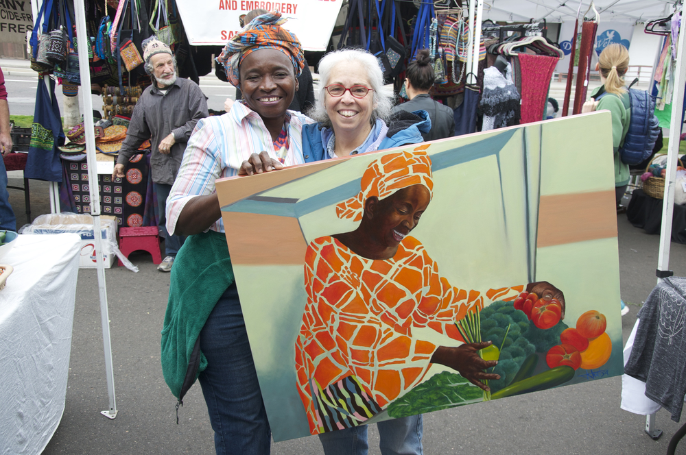 Jawn Golo of golofamilyorganicfarms.com receiving her portrait from artist, Jaswant Khalsa