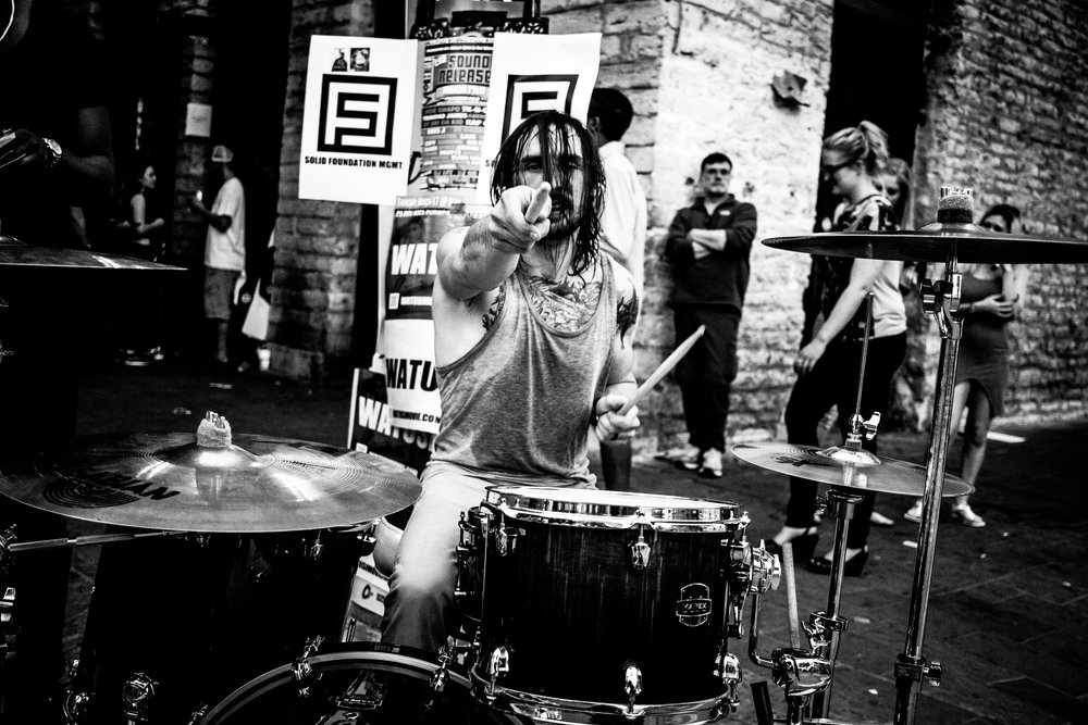 The streets of SXSW are insane and packed with people 24/7. I had some time to walk around and shot this photo of a street drummer. I love this shot but it never got shared.