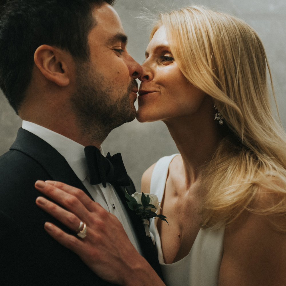 candid bride groom kiss photo