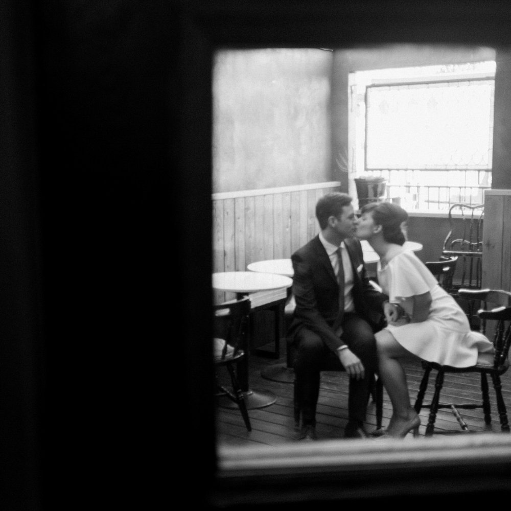 Black and white again, (no surprise) a little blur, a little haze, a sweet embrace, the kind of romantic expression that happens in the moment. I look for these frames endlessly.