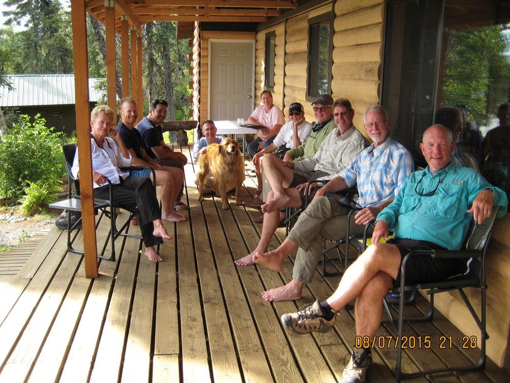 On the porch after a great day fishing. From the left, Maggie, Rob, Dave, Stephen, Parker-the-dog, Leslee, Diane, Lee, Harper, Don, and me.