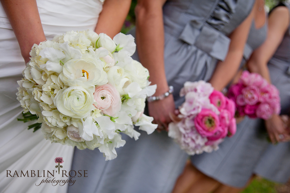 Bouquets of ranunculus, sweet peas, and Hydrangea