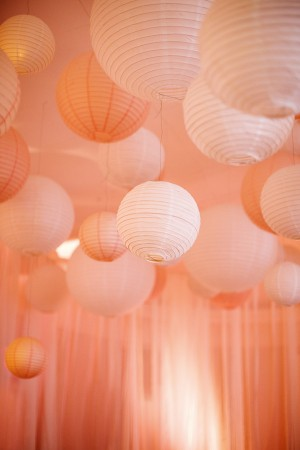 Pale pink and Peach Chinese Lanterns in the ballroom of Memphis Country Club.