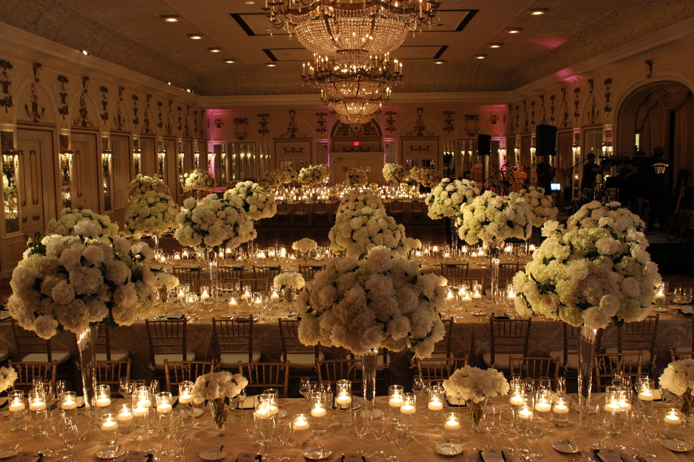 An abundance of centerpieces of White Hydrangea and White Peonies in the Continental Ballroom at The Peabody Hotel